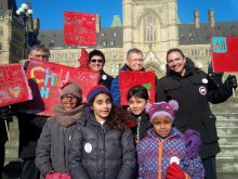 AFN Nation Chief Perry Bellegarde and former National Chiefs gather with children for Have a Heart Day on Parliament Hill.