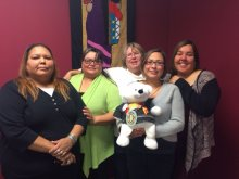 Spirit Bear poses with members of the WRCFS Waywayseecappo office