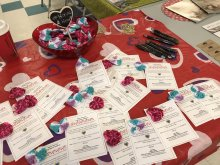 A table display at MBQ Family Well-Being Program's 7th Annual Have a Heart Day breakfast