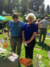 Jill Robinson Cooper (Bryce family member, right) at P.H. Bryce headstone in 2015